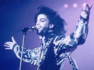 Prince smiling at mic