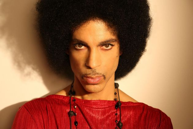 Prince 2015 looks at camera red shirt